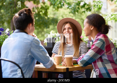 Students Chatting at Lunch in Cafe Outdoors - Stock Photo