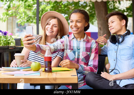 Young People Taking Selfie in Cafe - Stock Photo