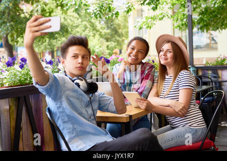 Cool Friends Taking Selfie in Cafe - Stock Photo