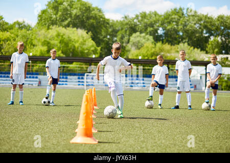 Team of Boys Training for Football Game - Stock Photo