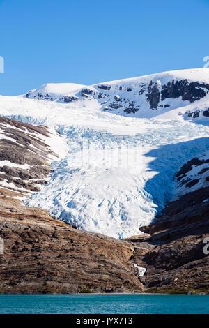 Engabreen or Enga glacier arm of Svartisen ice cap seen across Svartisvatnet or Engabrevatnet lake. Saltfjellet - Stock Photo
