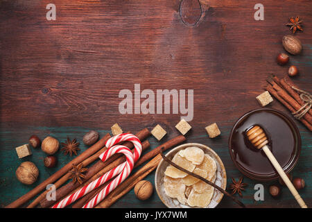 Winter spices and ingredients for cooking. Cinnamon sticks, hazelnuts, walnuts, nutmeg, cloves, anise stars on an - Stock Photo