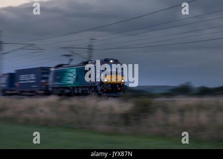 Direct rail Services Class 88 locomotive hauling a   Mossend Euro Terminal - Daventry Container train carrying freight - Stock Photo