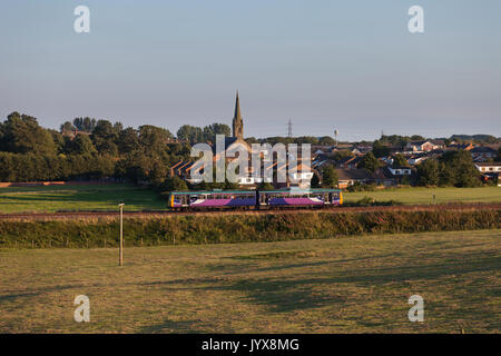 Northern Rail class 142 pacer train passes Kirkham and Wesham on the Preston - Blackpool line with the  1920 Blackpool - Stock Photo