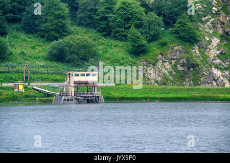 Small hydroelectric power station in mountains - Stock Photo