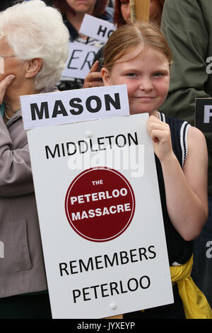 Manchester, UK. 20th Aug, 2017. A young girl stood with a placard which reads 'Mason Middleton' the event marks - Stock Photo