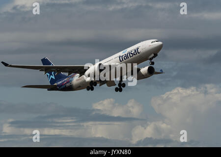 Richmond, British Columbia, Canada. 18th Aug, 2017. An Air Transat Airbus A330 (C-GUBD) wide-body jet airliner takes - Stock Photo