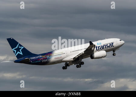 Richmond, British Columbia, Canada. 18th Aug, 2017. An Air Transat Airbus A330 (C-GJDA) wide-body jet airliner takes - Stock Photo