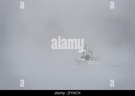 Fishing Boat On Lake In Thick Fog - Stock Photo