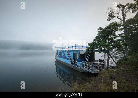 Houseboat Anchored On Foggy Lake - Stock Photo