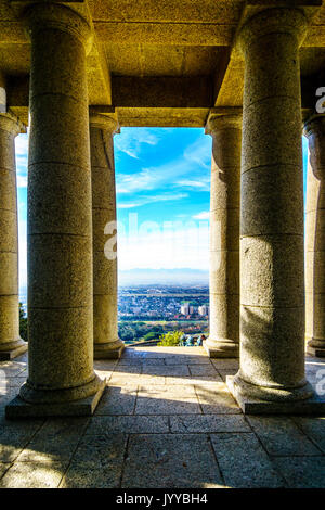 The Cape Peninsula seen from between the colonnades of Cecil Rhodes monument on the slopes of Table Mountain at - Stock Photo