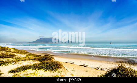 Early morning view of Cape Town and Table Mountain with Lion's Head and Signal Hill on the right and Devil's Peak - Stock Photo
