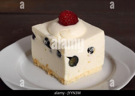 Frozen cheesecake with blueberry and raspberry - Stock Photo