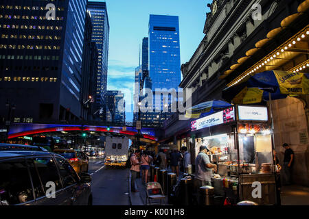 NEW YORK, NY - AUGUST 17: Summer evening with lights and busy 42 street near  Grand Central terminal  on August - Stock Photo