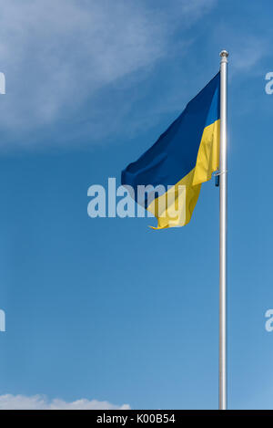 State flag of Ukraine, blue sky in the background - Stock Photo