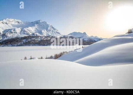 Landscape rounded by heavy snowfall overlooking Piz de la Margna. Canton of Graubunden. Engadine. Switzerland. Europe - Stock Photo