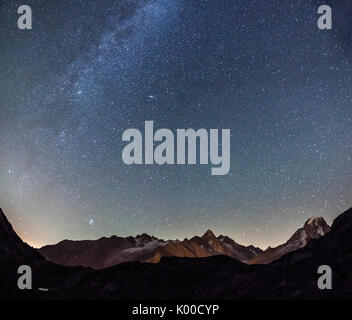 Starry sky over Mont Blanc range seen from Lac de Chesery. Haute Savoie. France - Stock Photo