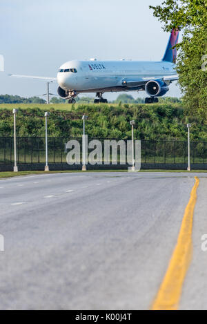 Boeing 767 Delta Air Lines passenger jet on the runway preparing for take off at Atlanta International Airport in - Stock Photo