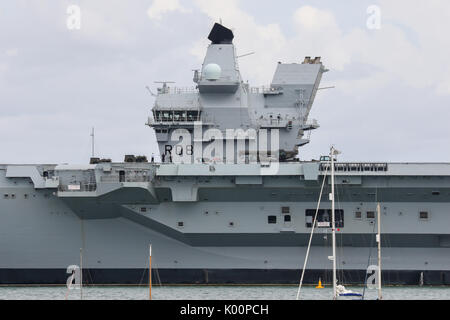 HMS Queen Elizabeth (R08) sits in HM Naval Base Portsmouth following arriving to her home-port for the first time - Stock Photo