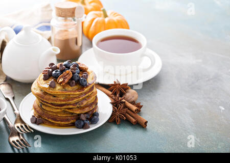 Pumpkin pancakes with berries and nuts - Stock Photo