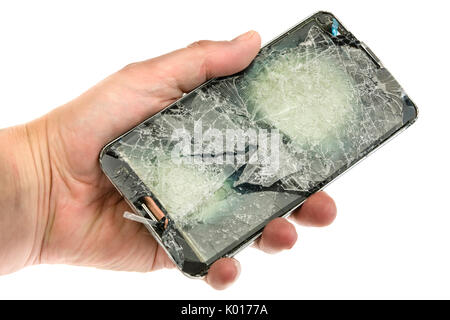 Mobile phone with a badly shattered screen after a serious fall. - Stock Photo
