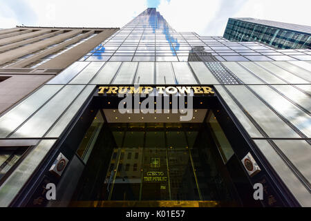 New York City - June 25, 2017: Gold facade of Trump Tower, the 68 story skyscraper home to Trump Organization political - Stock Photo
