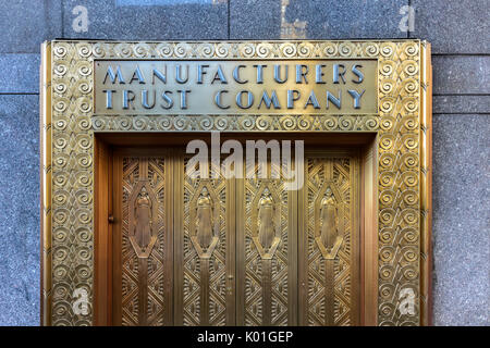 New York City - June 14, 2017: Manufacturers Hanover Trust Company Bank former bronze door entrance in midtown Manhattan - Stock Photo