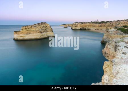 Top View of cliffs and turquoise water of Praia De Albandeira, Carvoeiro, Caramujeira, Lagoa Municipality, Algarve, - Stock Photo