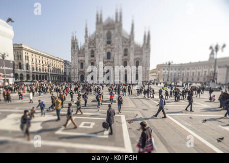 View of the square and the gothic Duomo the icon of Milan Lombardy Italy Europe - Stock Photo