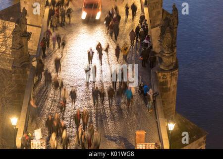 People on the historical Charles Bridge on Vltava (Moldava) river Prague Czech Republic Europe - Stock Photo