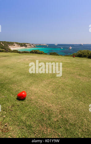 Sun shines on the green meadows of the golf course overlooking the turquoise sea Sperone Bonifacio South Corsica - Stock Photo