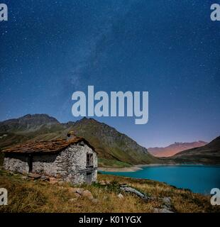 Panoramic shot showing the Milky Way over Lake Moncenisio - Alps, France. Europe - Stock Photo