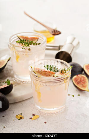 Pink fig cocktail with honey and thyme - Stock Photo