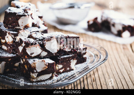 Traditional Christmas dessert chocolate rocky road bars on wooden table - Stock Photo