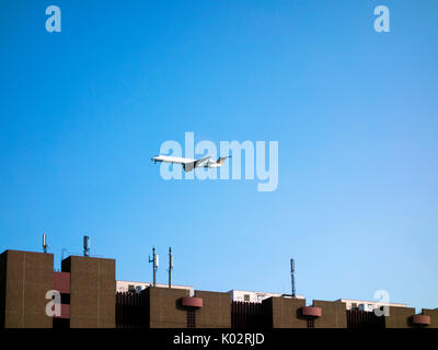 Passenger plane landing at Frankfurt airport - Stock Photo