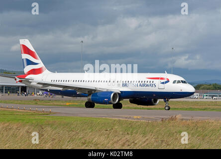 British Airways daily scheduled flight departing from Inverness airport in the Scottish Highlands. - Stock Photo