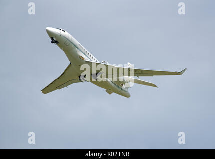 Falcon 7X from Air Alsie Fleet departing from Inverness Dalcross Airport in the Scottish Highlands UK. - Stock Photo