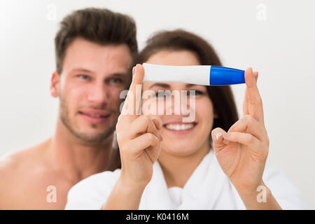 Happy Couple Showing Positive Pregnancy Shown In The Test Device - Stock Photo
