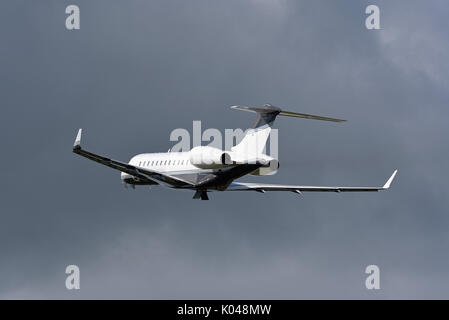 Bombardier Global Express BD 700 executive jet G-GLOB owned by Execujet of Cambridge taking off at Biggin Hill Airport, - Stock Photo