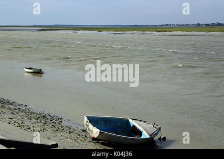 Rowing boats on Somme River at low tide from Quai Jeanne d'Arc, Saint Vallery sur Somme, Somme, Hauts de France, - Stock Photo