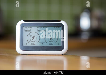 Domestic Energy Smart Meter on a Kitchen Worktop Displaying Electricity and Gas Usage in Real Time - Stock Photo