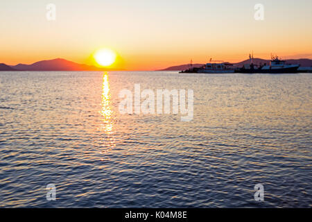 Scenic view of beautiful sunset in the evening time over the sea - Stock Photo