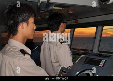 Merchant Marine Navigational Officers on Bridge Watch - Stock Photo