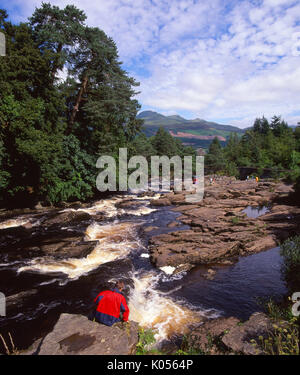 A beautiful summer view of the fast flowing Falls of Dochart situated in the picturesque village of Killin, Perthshire - Stock Photo