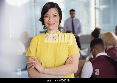 Portrait smiling, confident businesswoman in conference audience - Stock Photo