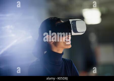 Businesswoman using virtual reality simulator - Stock Photo