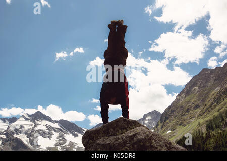 young boy doing headstand on trampoline stock photo  alamy