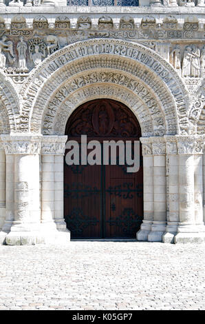 Door in West front of Church of Notre Dame le Grande, Poitiers, France, built second half of11th Century, in High - Stock Photo