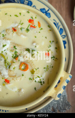 Traditional tripe soup on wooden table - Stock Photo