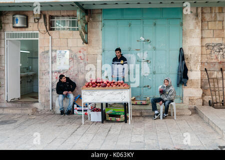 Street vendors sell freshly squeezed pomegranate juice in the Christian Quarter in Jerusalem's Old City. - Stock Photo
